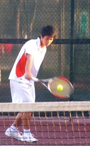 Man hitting tennis backhand
