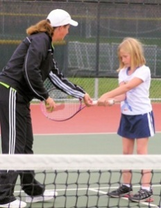 Kelly giving forehand instruction