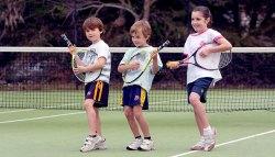 kids playing guitar with tennis racket