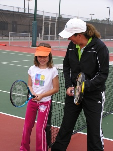 Girl learning tennis stance